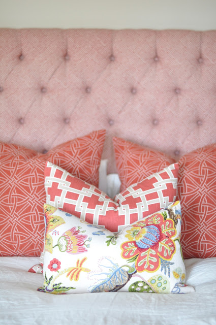Luscious cushions and pink tufted bedhead via Caitlin Wilson Design