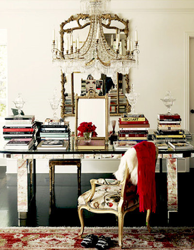 beautiful desk area with books and chandelier