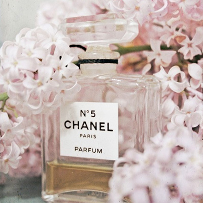 Chanel No. 5 perfume bottle and pink hyacinths