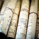 where would you like to go - luscious travel - rolled up maps