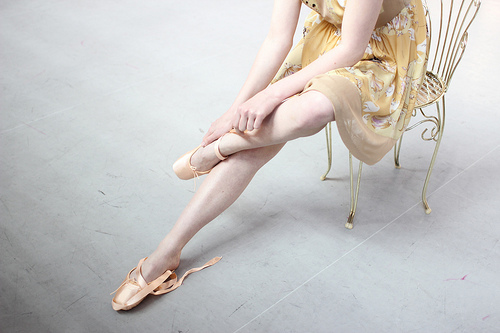 Pastel colors - ballerina in yellow frock on chair