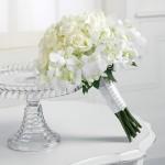 White bouquet of roses and stephanotis - wedding lusciousness