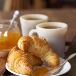 A luscious life - Coffee and croissant for breakfast