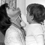 Jacqueline Kennedy playing with toddler John Jr