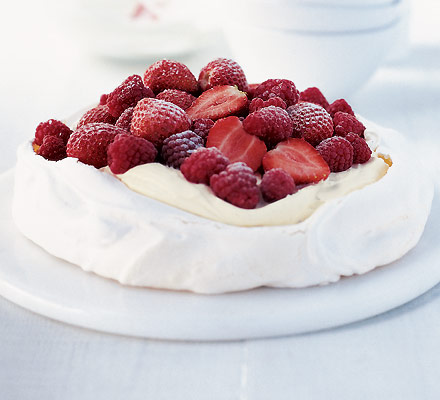 Luscious pavlova with cream and strawberries