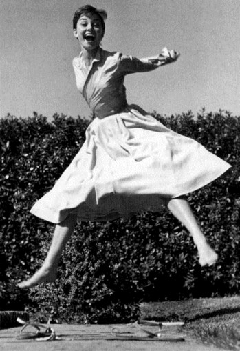 Audrey Hepburn laughing and jumping