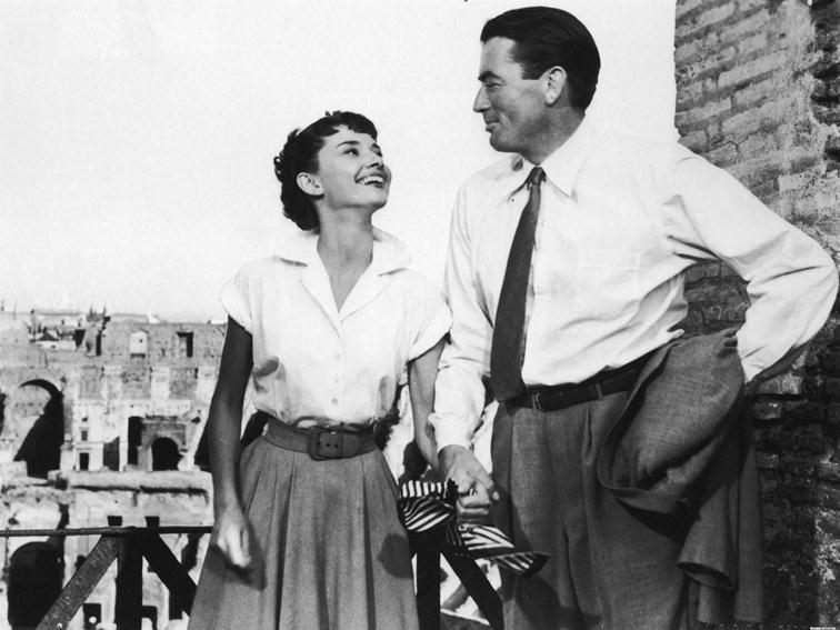 Audrey Hepburn laughing with Gregory Peck