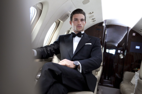 Cute boy in tux on private jet