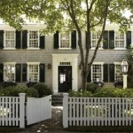 Grey black and white house - traditional home with picket fence