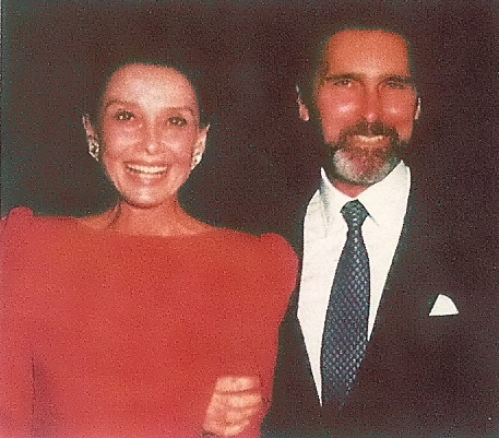 Audrey Hepburn in red dress with partner Robert Wolders