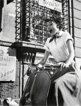 Audrey Hepburn on a vespa in Roman Holiday