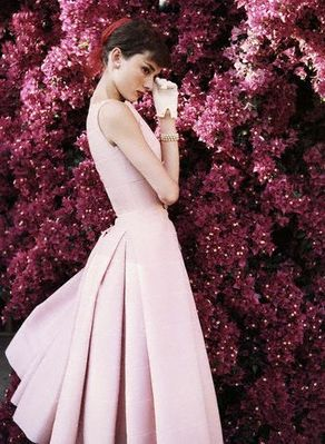 Audrey Hepburn in pink dress by Norman Parkinson