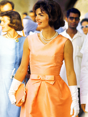 Jackie Kennedy in pale orange dress