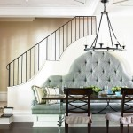 Dining area with tufted banquette seating and staircase