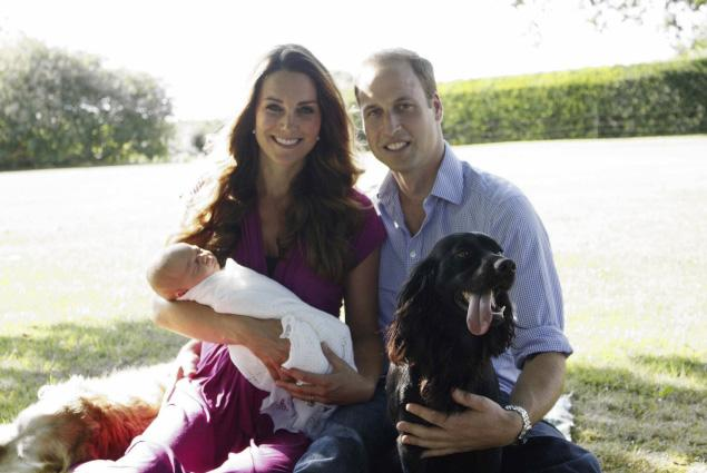 Prince George with parents Kate and William, and family dogs Lupo and Tilly