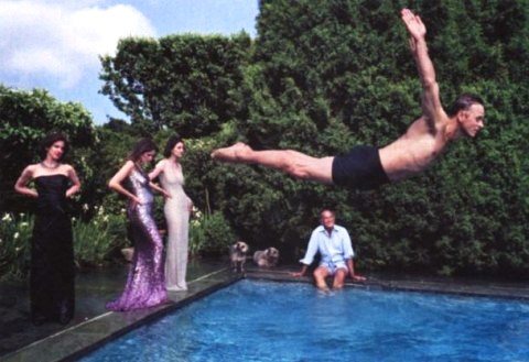 Mikhail Baryshnikov dives into the de la Rentas' Connecticut pool as the designer and three society beauties (Eliza Reed Bolen, Aerin Lauder, and Marina Rust) look on. Photo by Annie Leibovitz, September 2000.