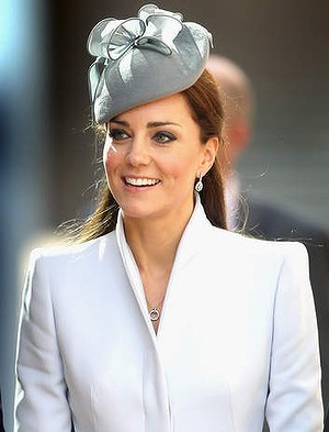 DUCHESS STYLE: Kate Middleton wears a dove grey funnel neck Alexander McQueen coat - St Andrews Cathedral Easter Day 2014