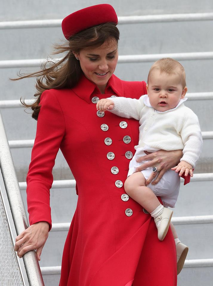 Prince George and the Duchess of Cambridge arrive in New Zealand - red outfit and hat 2014