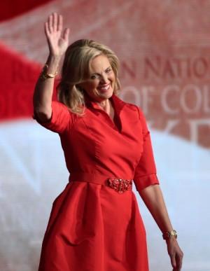 ann romney wears a vibrant red shirt dress by oscar de la renta