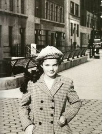 A young Jacqueline Bouvier Kennedy outside Chapin School for Girls in New York