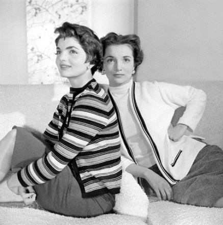 Mrs. John F. Kennedy (formerly Jacqueline Bouvier) wearing a striped wool sweater and Mrs. Michael T. Canfield (formerly Lee Bouvier) wearing a white cotton sweater with strips on pocket and edge (from left). 1955