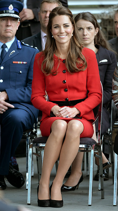 ROYAL TOUR: Kate Middleton in a red Luisa Spagnoli suit cinched in at the waist by a black belt
