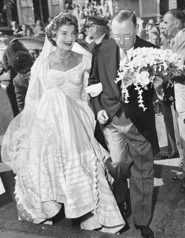 The wedding of John F. Kennedy and Jacqueline Bouvier 1953 - Jackie with her stepfather Hugh D Auchincloss