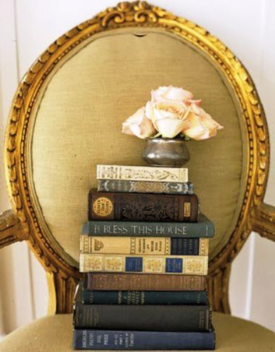 A pile of books on a gilt chair - Living lusciously