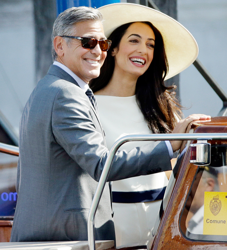 AMAL WEDDING CLOTHES: White pantsuit and white wide-brimmed floppy hat