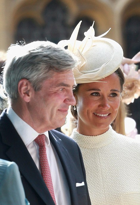 ROYAL CHRISTENING: Pippa Middleton wore bespoke Emilia Wickstead high-necked cream coatdress with patent nude heels custom-made straw cocktail hat from Jane Taylor
