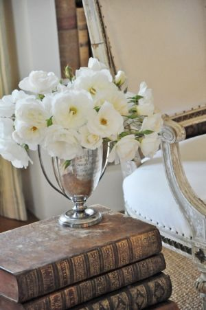 Celebrity closet ideas - old books and white flowers.jpg