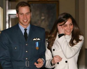 Britain's Prince William smiles as he walks with his girlfriend Kate Middleton at RAF Cranwell, central England