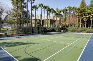 tennis-field-on-luxury-house-backyard luxury tennis and pool house pictures.jpg