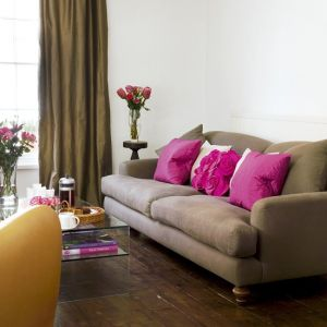 Pink interior design - myLusciousLife.com - Chocolate and Pink living room via House to Home.jpg