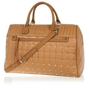 Beige stud quilted weekend bag.jpg