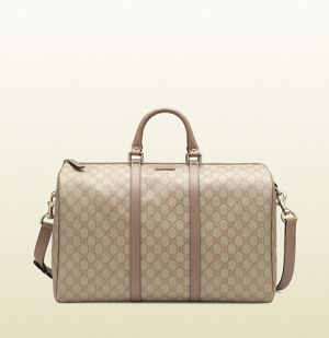 Gucci gg supreme canvas carry-on duffel bag.jpg