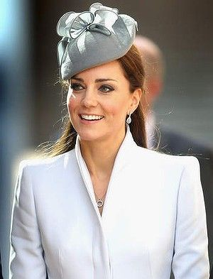 Kate Middleton wears a dove grey funnel neck Alexander McQueen coat - St Andrews Cathedral Easter Day 2014.jpg