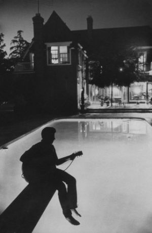 17-year-old Ricky Nelson plays guitar in the backyard of the Nelson family Hollywood home in 1958