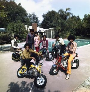The Jacksons join parents Joe and Katherine in their backyard in Encino California in 1970