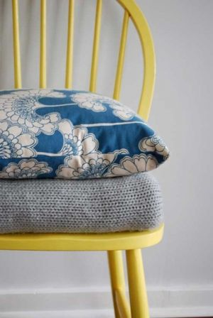 florence broadhurst cushions on yellow chair.jpg