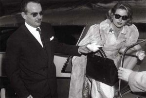 grace kelly and prince ranier with the hermes kelly bag.jpg