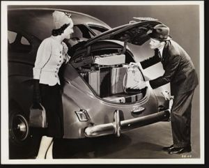 Vintage luggage - mylusciouslife.com - Man puts wifes suitcases in to back of car.jpg