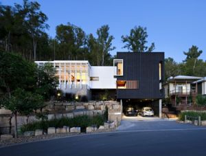 Black-And-White-Timber-Clad-3-Storey-House-On-The-Hill-Side-Stonehawke-By-Base-Architecture.jpg
